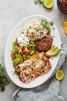 Easy cheese enchiladas are a great weeknight recipe! They're so easy to throw together and go great with all my favorite Mexican sides. #enchiladas #vegetarian #weeknightdinner