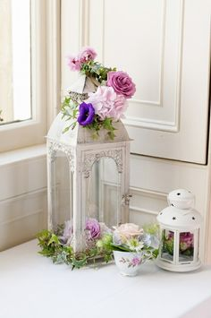 sc- Pretty decorated lanterns, teacup, display.