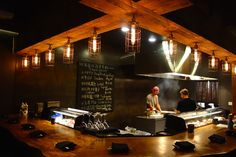 Kushido specializes in chargrilled skewers called Yakitori, grab a seat at the bar to watch the grilling action. - FERRON SALNIKER