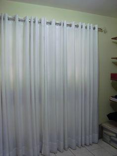 Veja em: http://roseliartesanatos.blogspot.com.br/2010/09/cortina-de-ilhos.html