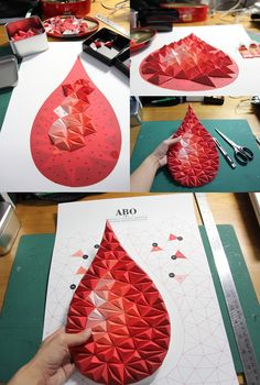 """""""Paste it on the numbers""""; this is not exactly origami, but it reminds me of it ; this one shows the frequency of blood groups in Singapore donor population; check out there website, they have more of this amazing paper art"""