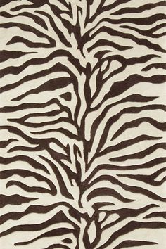 Walk on the wild side with the Dash and Albert Zebra Tufted/Carved Wool Rug. Dash and Albert Rugs always ship free at Lavender Fields