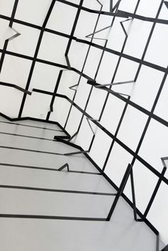 An interesting installation by Esther Stocker that plays with the Gestalt idea of multistability in that this form is a traditional grid that now has three dimensional elements and qualities to it.