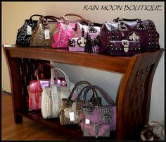 Our newest bold selections at Rain Moon Boutique  Handbags 45.00-50.00  Wallets 20.00  Please inquire about coordinating set pricing at Rain Moon Boutique