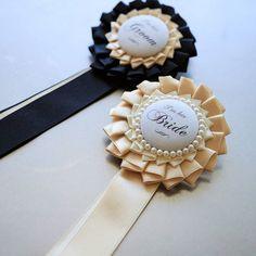 こちらは卒花嫁さまからお借りしたロゼット。 品のある色使いです。