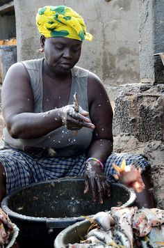 Cleaning fish, The Gambia.  Photo: C.Ladavicius, via Flickr