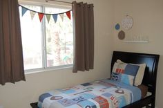 Boys Room, simple bunting dresses up space, cute banner across window