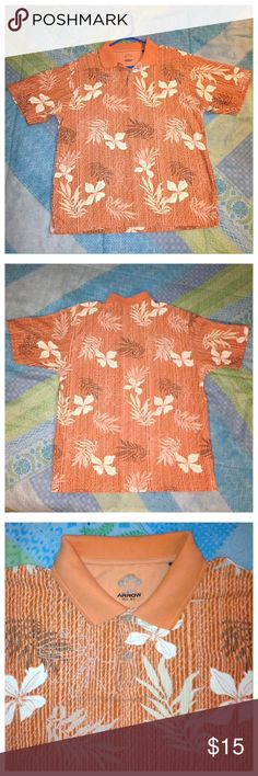 "1990's Arrow Brand, Hawaiian/Tiki Polo Shirt XL Vintage 1990's, Men's Arrow Brand, Orange Hawaiian/Tiki Short Sleeve Polo Shirt, Size XL.  Made of 60% cotton/40% rayon.  This is a really unique shirt.  Bright orange with Hawaiian/Tiki/Tropical Print, neutral colors of tropical print throughout.  Pointed collar is orange with two tan buttons.  Measurements taken w/shirt laying flat & are approx -23 1/2"" across the chest from underarm to underarm  -30"" long in back center of the shirt measured…"