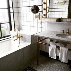 marble bathroom, brass fixtures