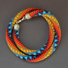 Love the nice bright colors. Crochet bead rope, pattern inspired by Anastasia Makeeva