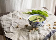 Green pea and sorrel soup with tofu, pistachios and lovage. Vegan, gluten free