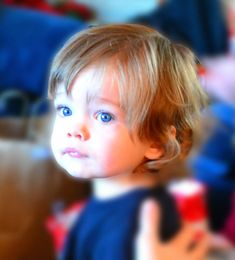 My toddler with his longish surfer boy hair and big blue eyes.