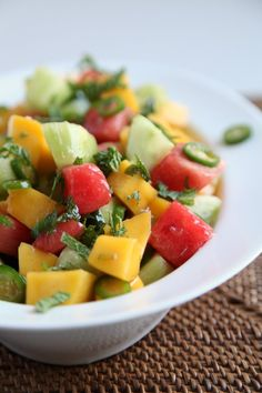 Pin for Later: What a Watermelon! 20+ Recipes That Highlight the Juicy Fruit Mango, Cucumber, and Watermelon Salad Playing with heat and umami, this watermelon salad recipe contains a few unlikely ingredients, for a result that is completely nosh-worthy.