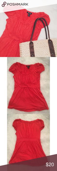 Coral Ruffle Top NWOT. This top is really soft! It would look so cute with white pants and nude wedges. Stretchy material. 95% Rayon, 5% Spandex.  ✅Reasonable offers welcome! ✅BUNDLE DISCOUNTS! 🚫No trades/paypal/other apps. 🚫No lowball offers Spring + Mercer Tops Tees - Short Sleeve