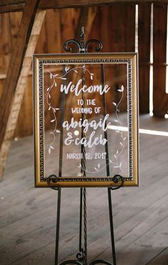 Hand-lettered Glass and Gold Wedding Welcome Sign by La Rue Louise | Photo by Veronica Young Photography #weddingsign #glass #handlettering #modernlettering #gold #welcomesign