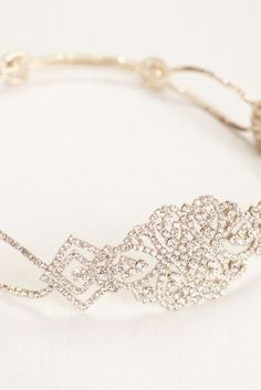 Get the classic Art Deco feel with this stretch crystal headband. Style 425053 by David's Bridal.