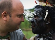 Face to face: Photographer Andrey Gudkov with the Dani tribal chief when he was granted rare access to visit the tribes