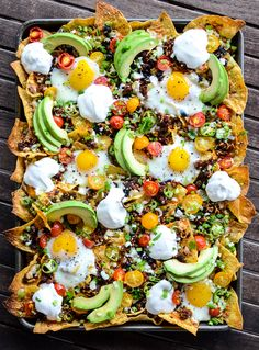 Huevos Rancheros Breakfast Nachos is a quick and easy recipe that will have the family fighting for leftovers! Those runny eggs make any meal complete. Breakfast Nachos, Breakfast Desayunos, Mexican Breakfast Recipes, Brunch Recipes, Mexican Food Recipes, Vegetarian Recipes, Cooking Recipes, Healthy Recipes, Pancake Recipes