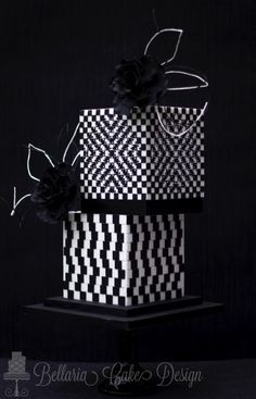 My submission for the American Cake Decorating magazine mrt/apr A few years ago I discovered that math can be more interesting than I initially thought. I absolutely love geometric patterns and designs and the optical illusions you create. Black White Cakes, Black And White Wedding Cake, White Wedding Cakes, Modern Cakes, Unique Cakes, Creative Cakes, Gorgeous Cakes, Pretty Cakes, Amazing Cakes