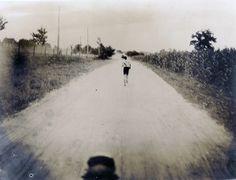 Thomas J. Hicks of Cambridge, Massachusetts YMCA leading the 1904 Olympic Marathon runners at the 20 mile mark.