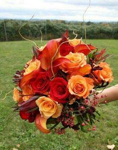 Autumn Wedding Bouquet Comprised Of: Red Roses, Orange Roses, Flame Orange Callas, Safari Sunset, Pepper Berries, Grape Vine××××