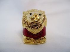 For your consideration is this beautiful Estee Lauder Royal Lion solid perfume compact designed by Judith Leiber for Estee Lauder in 2004. This compact is wonderfully made of a red enamel body, gold