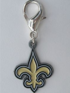 "Officially Licensed NFL Team Charms Perfect gift for four-legged ""Who-Dat"" fans of the New Orleans Saints! These jewelry-quality charms are crafted from antiqued, lead-safe pewter, and are hand- enameled.   Size: 7/8 x 2 1/8 in.   Made in the USA"
