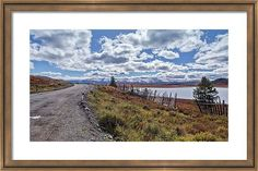 Framed Print featuring the photograph Mountain Road Near Lake by Oksana Ariskina  Vintage Fence in the vicinity of the mountain pass Ulaganskiy. Altai, Russia Photograph by Oksana Ariskina on @pixels and @fineartamerica  Buy print and other product with my fine art photography online: www.oksana-ariskina.pixels.com #OksanaAriskina  #FineArtPhotography #HomeDecor #FineArtPrint #PrintsForSale #Altai #Altay #Nature #Mountains #Ulagan