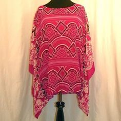 Madison Tunic Shirt Magenta, white, & black abstract/paisley print top. Built in magenta tank top. Breezy and comfortable. 100% Polyester. Madison Tops Tunics