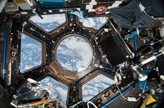 """canadian-space-agency:  """"The busy International Space Station cupola. That's us in the window."""""""