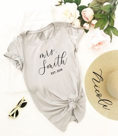is the perfect place to find gorgeous wedding bridal party gifts, bridal swag, wedding event decor and pretty personalized things. Honeymoon Gifts, Honeymoon Outfits, Honeymoon Places, Honeymoon Ideas, Personalized Shirts, Custom Shirts, Mrs Shirt, Bride Shirts, Bridal Boutique