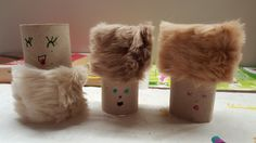 Fuzzy-Head-Family!  How to make fuzzy-head-puppets? 1) collect toilet-paper-rolls 2) fake fur swatch-card from last years developments.. 3) lets think about faces, expressions?