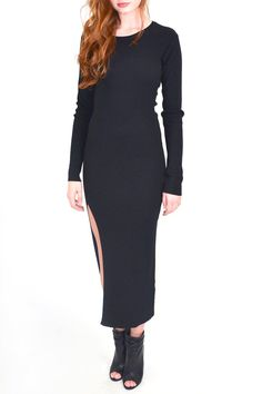 Black dress featuring a round neck long sleeves allover ribbing and a high right side slit.This dress is so versatile youre sure to fall in love with it! You can wear this dress with heels and a statement necklace or throw on a faux fur vest/jacket and add a layer of warmth to your outfit!  Ribbed Slit Dress Clothing - Dresses Pennsylvania