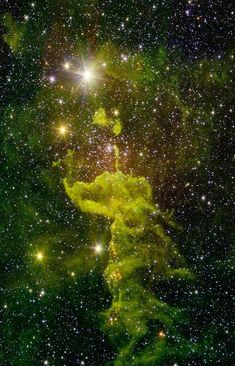 "A nebula known as ""the Spider"" glows fluorescent green in an infrared image…"