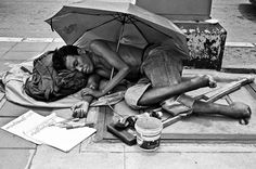 impoverished man on the street - black and white