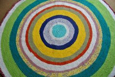 A rug made from strips of stretch knit fabrics