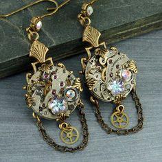 Steampunk Earrings Crystal Flower Steampunk Earrings Steampunk Chandelier Earrings Brass Filigree Vintage Watch Silver Pink Lavender. $45.00, via Etsy.