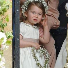 Duchess Catherine, her children Prince George of Cambridge, page boy and Princess Charlotte of Cambridge, flower girl attend the wedding of Pippa Middleton and James Matthews at St Mark's Church on May 2017 in Englefield Green, England