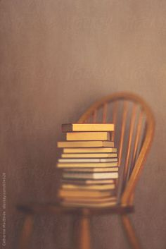 Wooden chair and books... by CatMacBride | Stocksy United