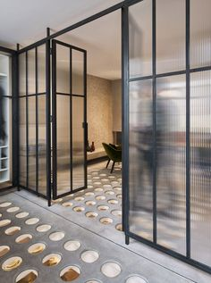 The glass partition doors assist in opening the space up, while also enhancing the natural light. Tagged: Doors, Metal, Interior, and Swing Door Type. Photo 9 of 11 in A London Townhouse Has Glass Circles in Its Floors to Filter in Ample Natural Light. Georgian Terrace, Georgian Townhouse, London Townhouse, Georgian House, Terraced House, Architecture Restaurant, Interior Architecture, Interior Design, Steel Windows
