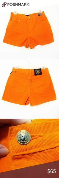 """Versace Vintage High Waisted Jean Shorts Vintage, high waisted, bright orange Versace Jeans Couture shorts. Medusa logo on buttons and studs as well as back logo. Small piece of leather missing at the top of large back logo (can see in upper right of logo pic). Small areas of faded coloring on right back side (pictured) and also barely noticeable fade on back middle seam (last pic). Approximate flat lay measurements are 15"""" waist, 11.5"""" rise and 2.5"""" inseam. Tag says XL but it seems to be…"""