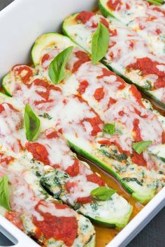 Spinach and Cheese Lasagna Stuffed Zucchini Boats, with four cheeses! This lighter take on lasagna is quick and easy to make! Vegetarian + Gluten Free.   www.kristineskitchenblog.com