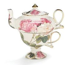 New romantic gift decor rose victorian porcelain teapot wedding & anniversary gifts elegant teapot and teacup duo designed in a beautiful victorian rose design comes in a satin lined gift box. Elegant victorian porcelain teapot and teacup for one trimmed in goldteapot holds 13 oz of your favorite tea teacup holds 8 ozcomes in satin lined gift boxtea set measures: 6 1/2 highdishwasher safe/fda approved thank you for looking on our list welcome to buy your own now! :) Free shippi...