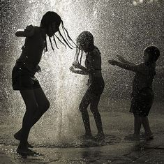 Photography by Lance Ramoth   black and white This is one thing my grand kids love is playing in the water!
