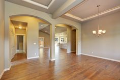 Coffered ceilings in the entry & formal dining room with crown molding and LED rop lighting.