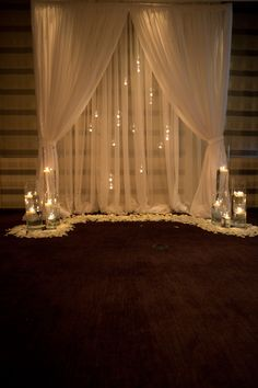 """Use pvc pipe to frame a archway. With a """"bay window"""" shape.  hang clear christmas bulbs with lights for """"bubbles, or possibly flowers instead. Love the candle lighting and petals scattered around."""