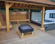Outdoor entertainment area with hot tub