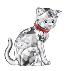 Swarovski Mother Cat. Swarovski Mother Cat  This Swarovski cat mother sports a bright Red Color. Designed in clear crystal with jet black eyes, she looks so protective,as a mother could would, when displayed with the new Swarovski kittens overseeing their activities.