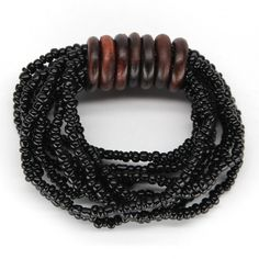 DERING BRACELET Multiple strands of glass beads on stretch cord with sustainable indian rosewood ring accents. Matches our Dering Necklace. Handmade by talented artisans in developing countries. Fair trade. Imported.
