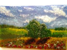 """My love of impressionist art inspired this fused glass landscape, made entirely of glass.  I used sheet glass as a base, then mixed various colors and sizes of frit (crushed glass) as my palette. The piece was kiln-fired five times, adding more elements with each firing. Firing only up to 1380 degrees allowed the finished piece to retain a beautiful texture and depth.  This art glass panel measures 8 3/8"""" wide by 5 3/8"""" tall and is approximately 1/2 thick.  Thank you for taking the time to…"""